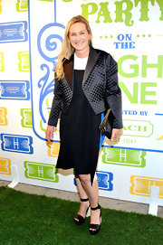 Anne Slowey chose a boxy black blazer to pair over her free-flowing dress.