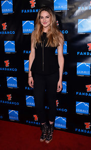Shailene lengthened her silhouette with a solid black jumpsuit that featured a peplum waist for a fun added detail.