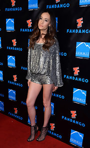 Maggie Q sparkled in a perfectly draped, silver-sequined romper.