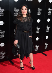 Salma Hayek complemented her dress with black ankle-strap platforms by Christian Louboutin.