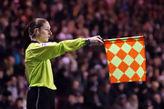 Assistant referee Sian Masset usually wears her hair in a simple ponytail during matches.
