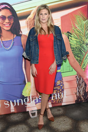 Alexandra Richards layered a denim jacket over her dress for a more relaxed finish.