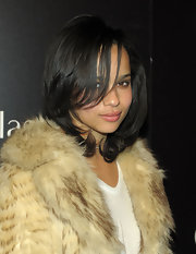 Zoe Kravitz showed off her layered raven locks at the opening of the Sunglass Hut store.