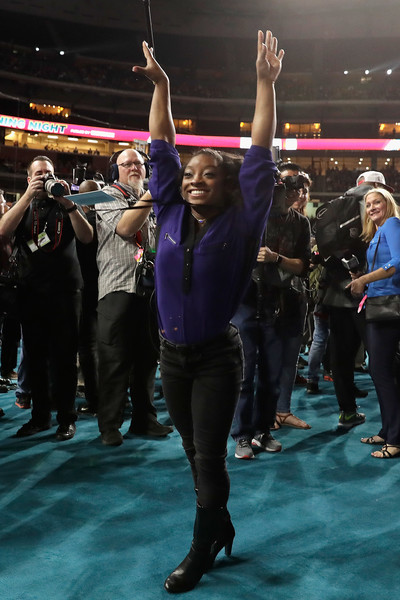 Simone Biles teamed a purple tunic with black jeans for the Super Bowl 51 opening night.