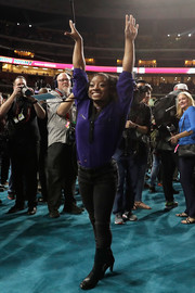 Simone Biles completed her ensemble with black mid-calf boots.