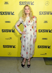 Amanda Michalka paired her lovely dress with black knot-detail peep-toes by Christian Louboutin.