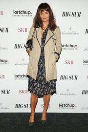 Helena Christensen attended the 'Big Sur' premiere in NYC wearing a light trenchcoat over a print dress.