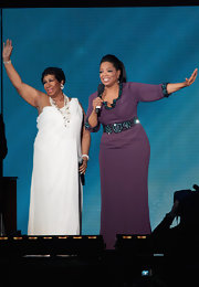 Oprah Winfrey looked regal in a plum-colored evening dress with a beaded waist and neckline during her 'Farewell Spectacular.'