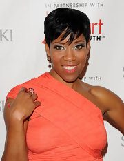 Regina King wore metallic eyeshadow for a smoldering look during the Red Dress fashion show.