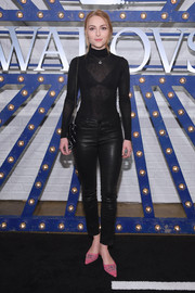 AnnaSophia Robb teamed her top with black leather pants by J Brand.