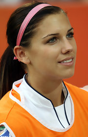 Alex Morgan wears a pink headband after this World Cup match against Sweden.