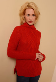 January Jones bundled up for her Sundance Film Festival portrait in this bright red cable-knit sweater with mock-neck.