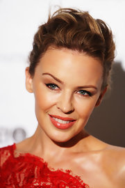 Kylie Minogue attended the Sydney Mardi Gras VIP Party wearing her wavy tresses in a casual updo.