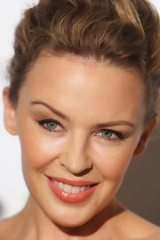 Kylie Minogue attended the Sydney Mardi Gras VIP Party wearing a lovely glossy coral lipstick.