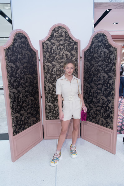 Sydney Sweeney Crosstrainers [nordstrom host private event to celebrate the opening of new handbag shop,pink,fashion,long hair,dress,room,shoe,sydney sweeney,downtown seattle,washington,gucci,nordstrom]