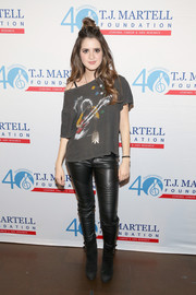 Laura Marano amped up the edge with a pair of black suede moto boots.