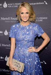 Carrie Underwood made sure she totally sparkled at the T.J. Martell Foundation gala by pairing a gemstone-embellished clutch with her sequined dress.