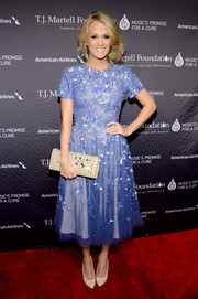 Carrie Underwood was all about girly charm in this sequined blue fit-and-flare dress by Randi Rahm during the T.J. Martell Foundation gala.