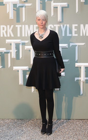 Kate Lanphear donned an edgy-chic black sweater dress for the Salone Internazionale del Mobile celebration.