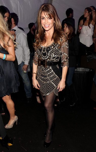 Paula Abdul teamed her flirty mesh cocktail dress with black patent pumps.