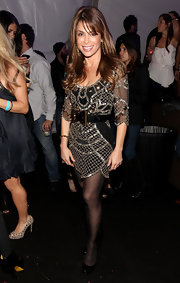 With another season of American Idol sans Paula Abdul, it's refreshing to see the spunky sweetheart out on the town. Paula attended the T-Mobile Sidekick Launch party wearing a beaded mini dress with sheer black tights and black patent pumps. Looking good!