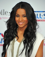 Ciara showed off her long center part curls at the NBA All-Star game.