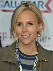 Tory Burch added a dash of elegance to her look with pink gemstone earrings.