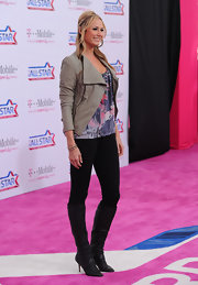 Stacy Keibler wore black textured knee high boots to the NBA All-Star Game.