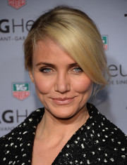 Cameron Diaz looked divine wearing her hair in a chignon with dramatic side-swept bangs during the Tag Heuer New York City store opening.