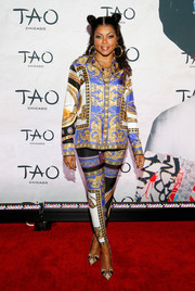 Taraji P. Henson attended the TAO Chicago grand opening wearing a baroque-print tunic.