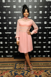 Karrueche Tran went the modest route in a long-sleeve pink Gucci dress with an embroidered bodice at the TCA Turner Winter Press Tour.