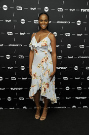 Tika Sumpter looked romantic in a baby-blue floral wrap dress with ruffle accents at the TCA Turner Winter Press Tour.