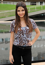 Victoria Justice wore a leopard-print buttoned blouse to the Teen Vogue Declare Your Denim Fashion Show.