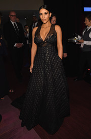 Kim Kardashian looked ravishing at the Time 100 Gala in a sheer-panel black and silver Sophie Theallet gown that was very flattering to her voluptuous figure.