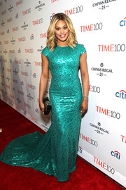 Laverne Cox radiated on the Time 100 Gala red carpet in a fully sequined aqua-green gown by Marc Bouwer.