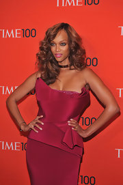 Tyra channeled Farrah Fawcett with her voluminous '70s waves at the Time 100 Gala.