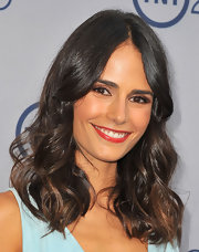 Jordana brightened up her olive skin and smoky brown eyes with a bold and supple red lip.