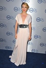 Sarah Carter blended Grecian beauty with old-Hollywood glamour when she donned this nude draped gown.