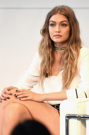 Gigi Hadid sported Tommy Hilfiger's logo on her nails--a clever marketing gimmick for the brand!