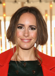 Louise Roe pulled her hair up into a romantic faux bob for the Jenny Packham fashion show.