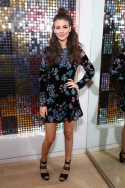 Victoria Justice teamed her dress with black multi-strap heels.