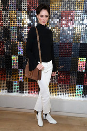 For her arm candy, Coco Rocha chose a tan suede shoulder bag.