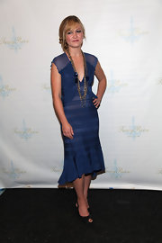 Julia Stiles paired her blue sheer dress with black satin peep toes.