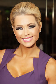 Nicola McLean opted for subtle jewelry -- a pair of diamond studs -- for the TRIC Awards 2012.