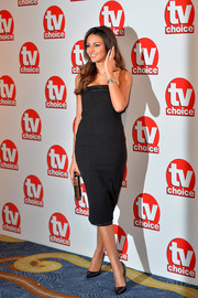 Michelle Keegan complemented her dress with a pair of black patent pumps by Kurt Geiger.
