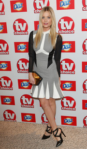 A bronze clutch sits pretty at Laura Whitmore's side.