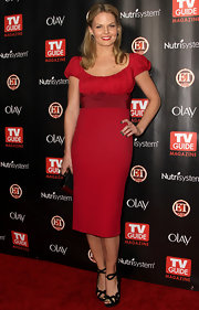Jennifer contrasts her bright red dress and lips with black finger nail polish.