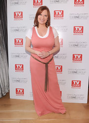 Caroline Manzo went for a casual boho feel with a pink maxi dress at the TV Guide Magazine/Andy Cohen book signing party.