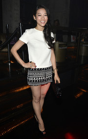 Arden Cho styled her top with a cute pair of black-and-white short shorts by Topshop.
