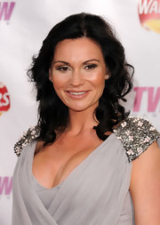 A romantic curly hairstyle completed Lucy Pargeter's goddess look.